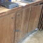 How to Improve Lighting In Your Workshop by Painting Cabinets