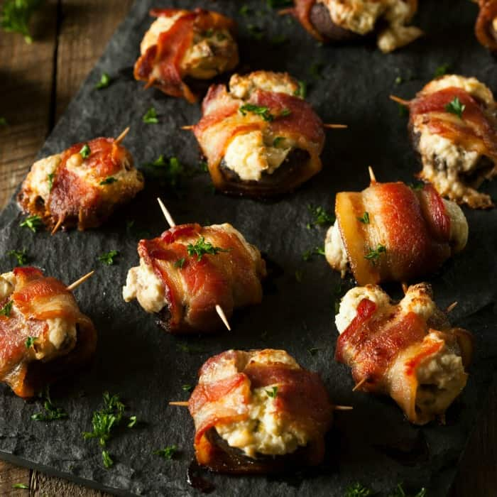 These delicious bacon-wraped turkey and mushroom poppers are the perfect appetizer recipe for a New Years party or just an awesome use of leftover turkey. LOVE!