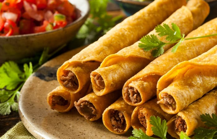 easy recipe for making taquitos in the oven feature