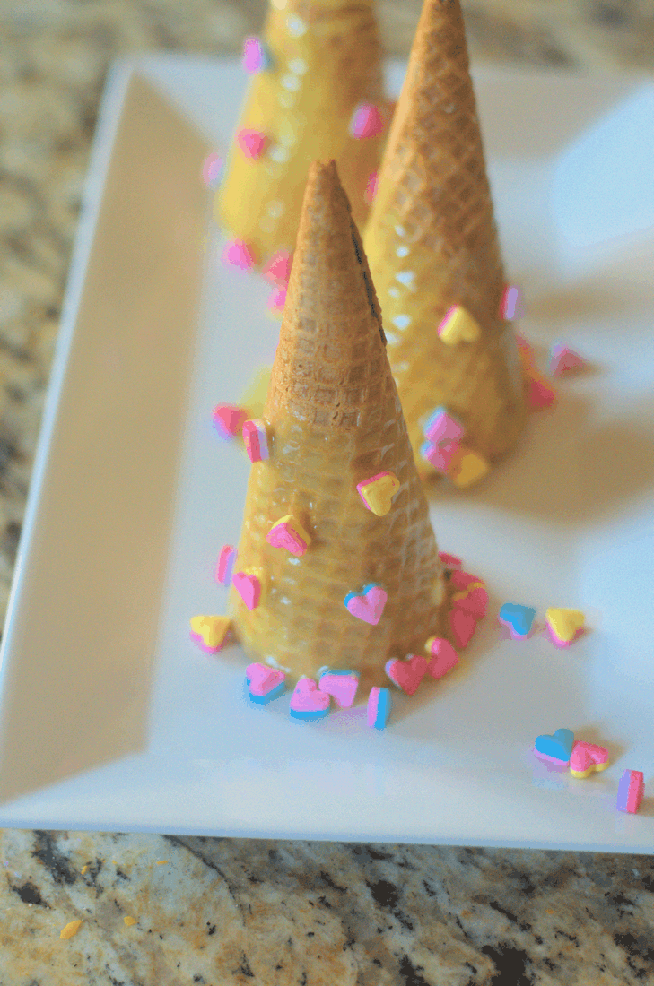 Never eat a unicorn horn, right? Not this one--super simple, kind of silly and really fun, you can have these party snacks made in about 5 minutes--and they're the perfect foil for Unicorn Ice Cream. Get your Simple Unicorn Horn Snacks ready because the horn-snackahton is about to be so on. #nerdymammablog #unicorn #unicornhornsnacks #unicornsnacks #unicornfood #unicornsnack #funfood #sillyfood #foodart #simplesnacks #snacksforkids #unicornparty #partyfood #unicornpartyfood #party