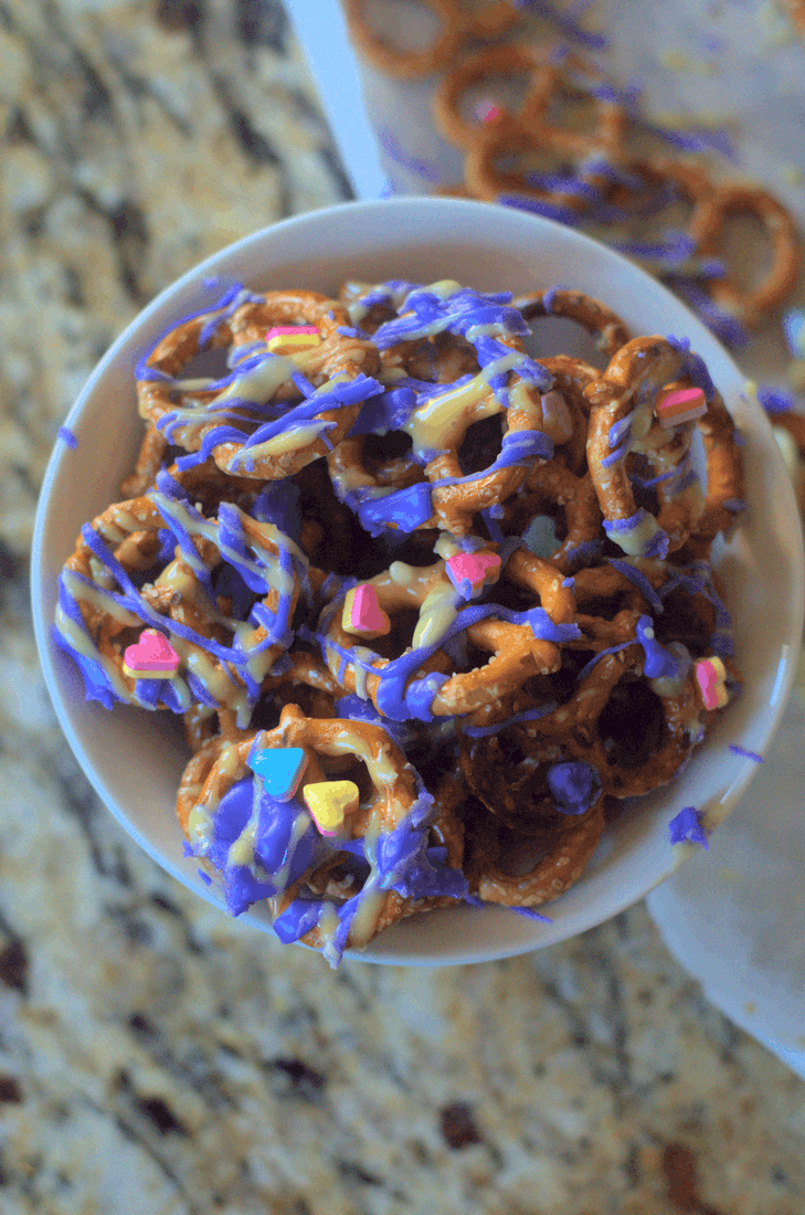 Nocking another simple party food out for a unicorn party...the ultimate in easy:Stupid Simple Unicorn Pretzels. You can't go wrong with pretzels, but if you're throwing down the ultimate unicorn party, this is the perfect snack to go along with all the sweets. And so simple you can make it anytime just for a smile. #nerdymammablog #unicorn #unicornsnack #unicornsnacks #unicornfood #unicornparty #party #partyfood #unicornpartyfood #funfood #sillyfood #funsnacksforkids #easypartyfood