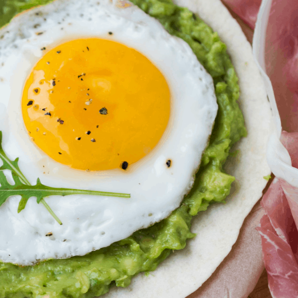 This is the simplest recipe for Fried Egg and Avocado Breakfast Tacos. So yummy! #breakfast #easy #taco #tacorecipe #recipe #breakfastrecipe #breakfasttacorecipe