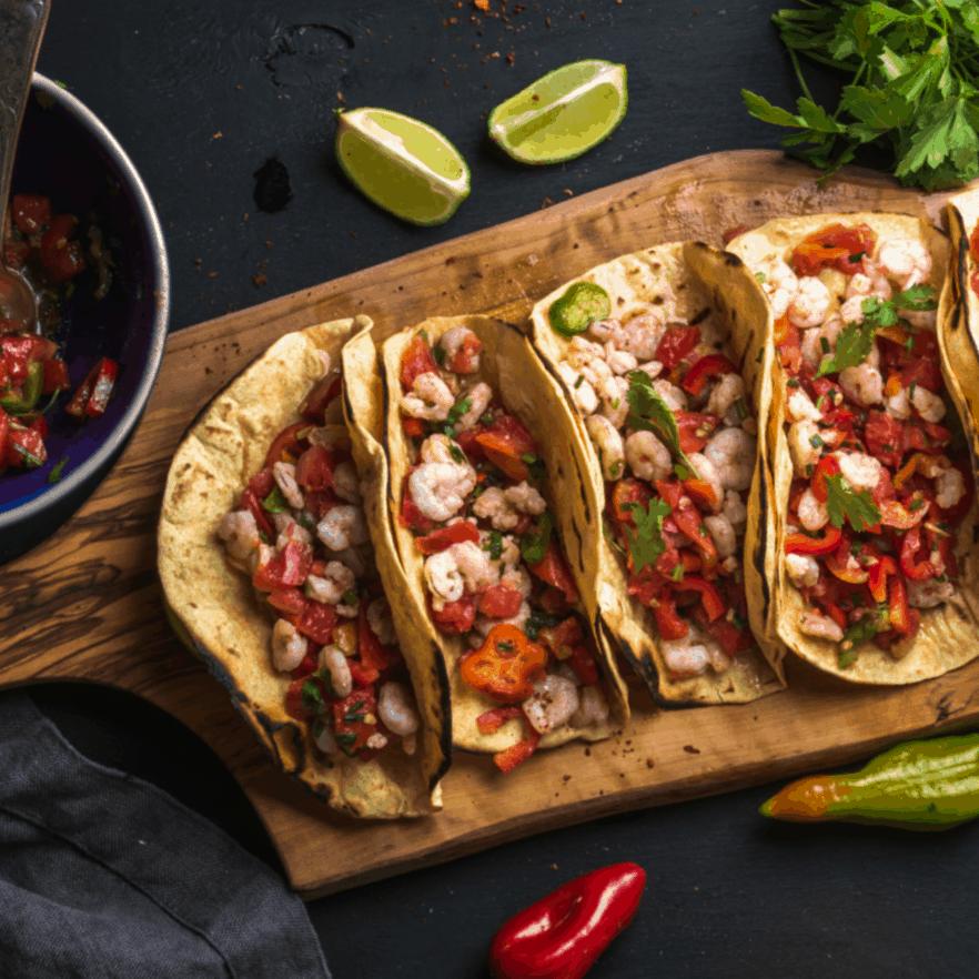 OMG! This Stupid Simple Shrimp Taco recipe is so ridiculously easy. SO FAST! #shirimp #easy #recipe #shrimptaco #mexicanfood #simpleshrimptaco