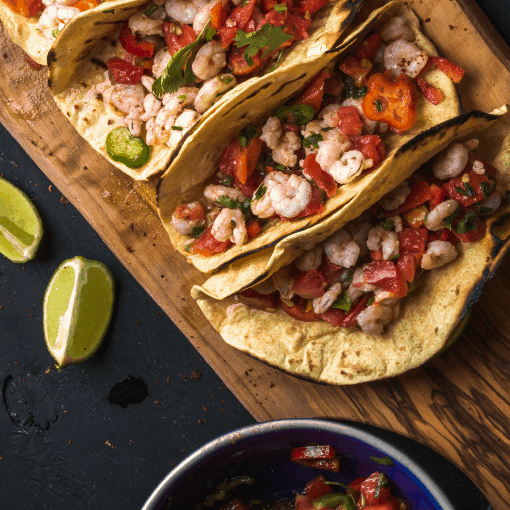 OMG! This Stupid Simple Shrimp Tacos recipe is so ridiculously easy. SO FAST! #shirimp #easy #recipe #shrimptaco #mexicanfood #simpleshrimptaco
