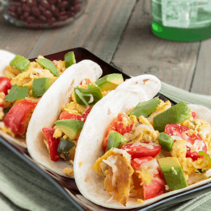 Holy Moley! These Authentic Mexican Breakfast Tacos are insanely yummy! #recipe #tasty #food #breakfast #breakfastrecipe #taco #tacos #tacorecipe #breakfasttacorecipe #authenticmexicanfood #authenticmexicanbreakfast #migas #migastaco