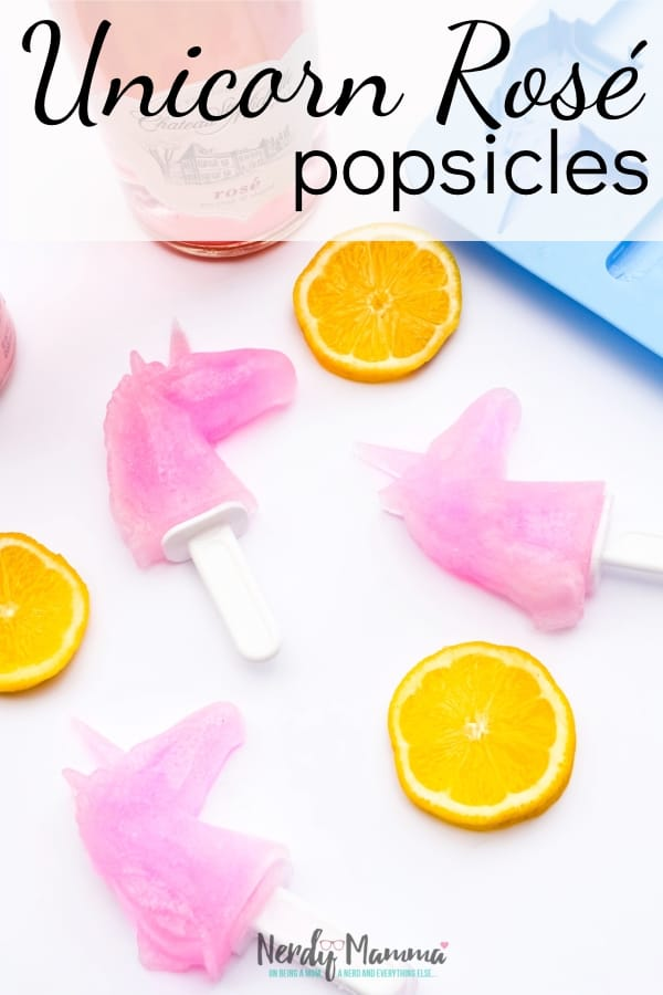 A special friend, a special bottle of adult beverage, and a unicorn popsicle mold--this is recipe for Rosé Unicorn Popsicles is so easy, but so awesome. You seriously need these for your next adult backyard fest. Seriously. #nerdymammablog #unicorn #adultbeverage #rose #popsicle #adultpopsicle #alcoholpopsicle #unicornpopsicle