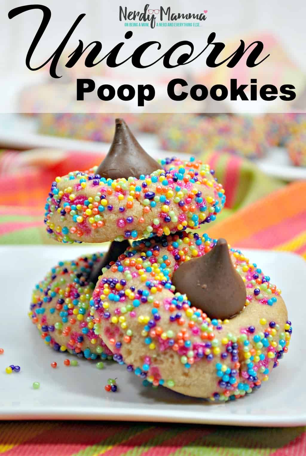 In a world where unicorns and their poop are so cute, I bring you, the best bringing-together of rainbow-goodness and poop: Unicorn Poop Cookies.) Simple, fun and oh, so tasty, these are a super-fun snack for any kid. #nerdymammablog #unicorn #unicornpoop #unicornrecipe #unicornpooprecipe
