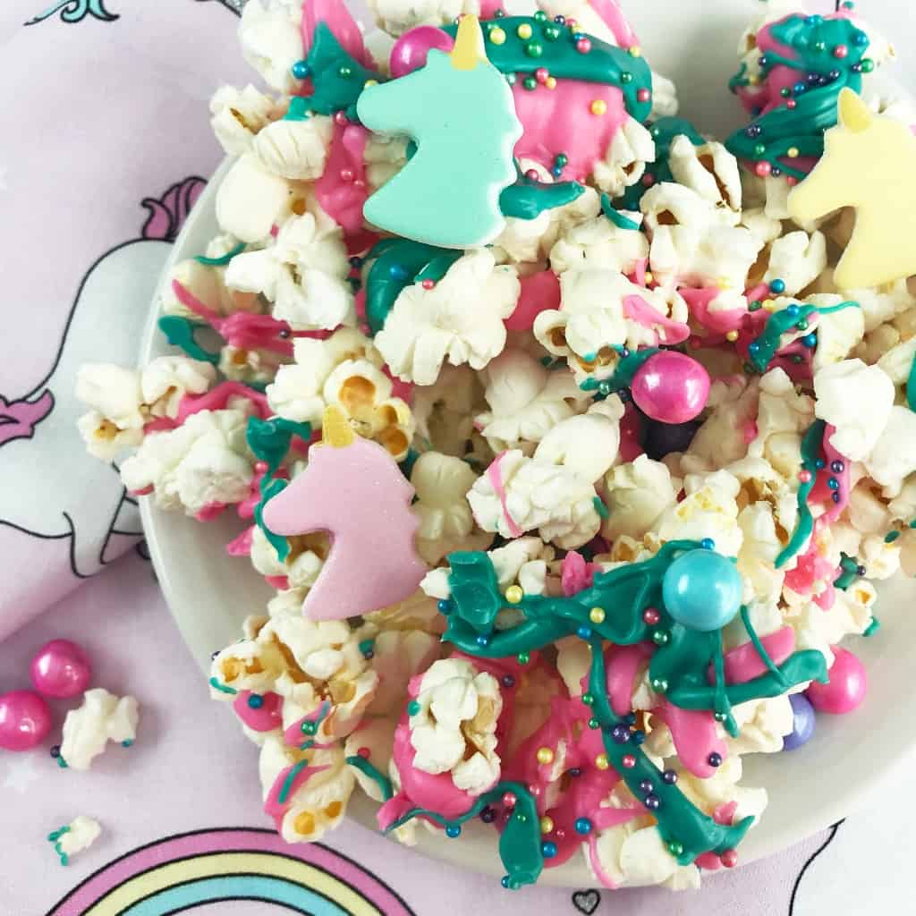 """Snack time needs be boring no more! Gimme about 5 minutes and you'll have an epic Unicorn Candy Popcorn to make the kids giggle and bring their afternoon snack into the """"fun"""" zone. #nerdymammablog #unicorn #popcorn #unicornpopcorn #snack #recipe"""