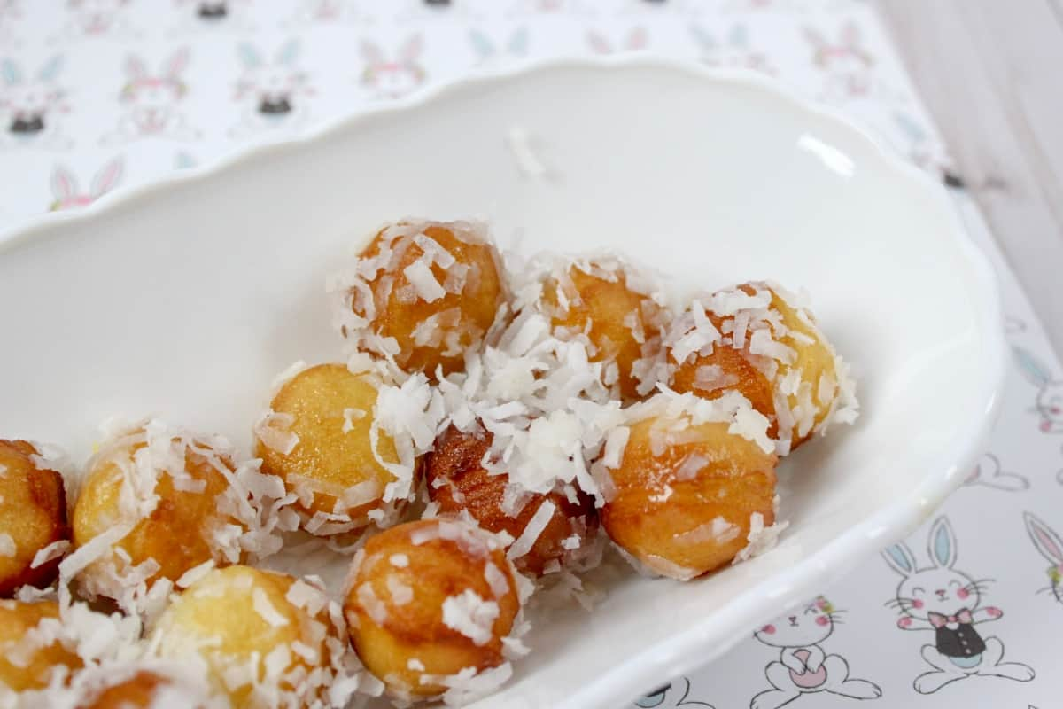 My kids were in need of a snack. And not just any snack. They wanted Coconut Donut Holes. But it was well past 2pm and the donut shop was closed. This mom is not without resources though--and so I made homemade Coconut Donut Holes! #nerdymammablog #donut #doughnut #recipe #breakfast