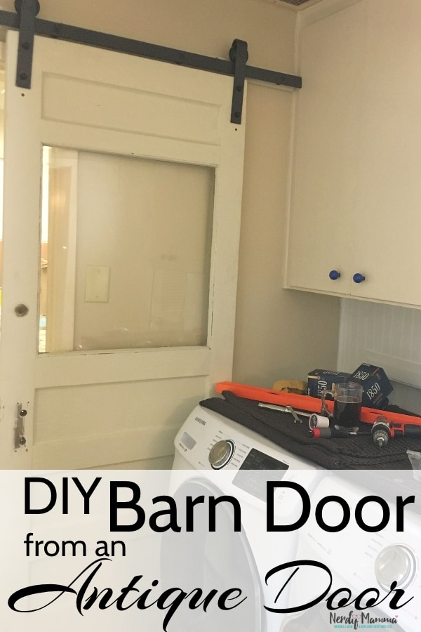 #ad This house has no freaking laundry room door and I'm going insane without one. Well, I was. Now, the noise level has decreased substantially and it's all because of a DIY Barn Door from an Antique Door. #InspireYourBold #diy #barndoor #nerdymammblog