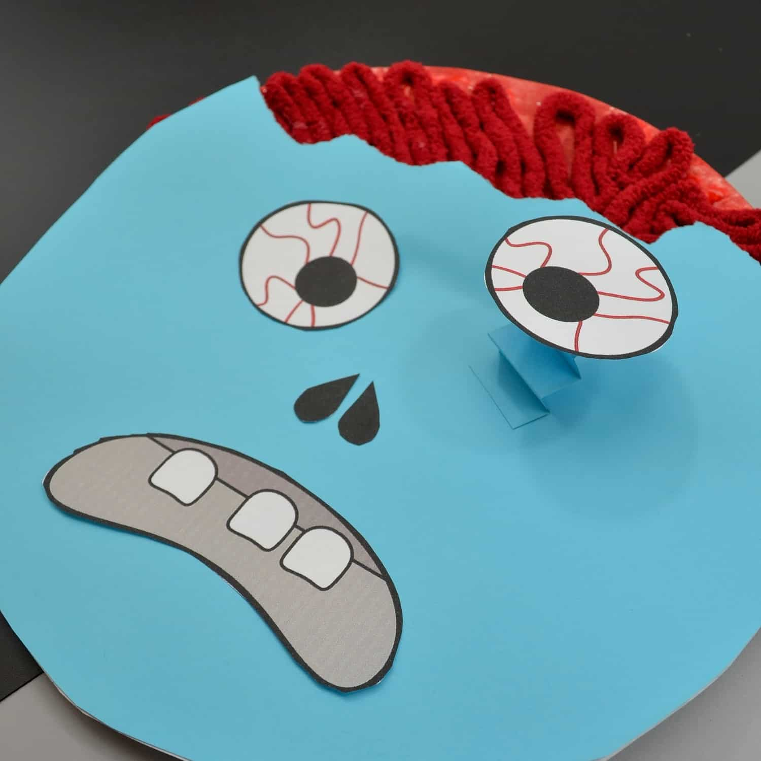Look, kids need a little braaaaaaiiiiiinnnss in their life. You can totally do this any other month by like educating them. But in October...we need the real thing. Real brains. And this Zombie Paper Plate Craft is the way to feed them all the braaaaaaaiiiiiinnnss. #nerdymammablog #halloween #craft #zombie