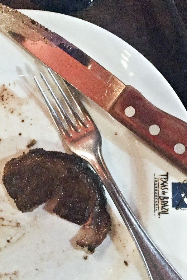 steak on a plate with a knife and fork