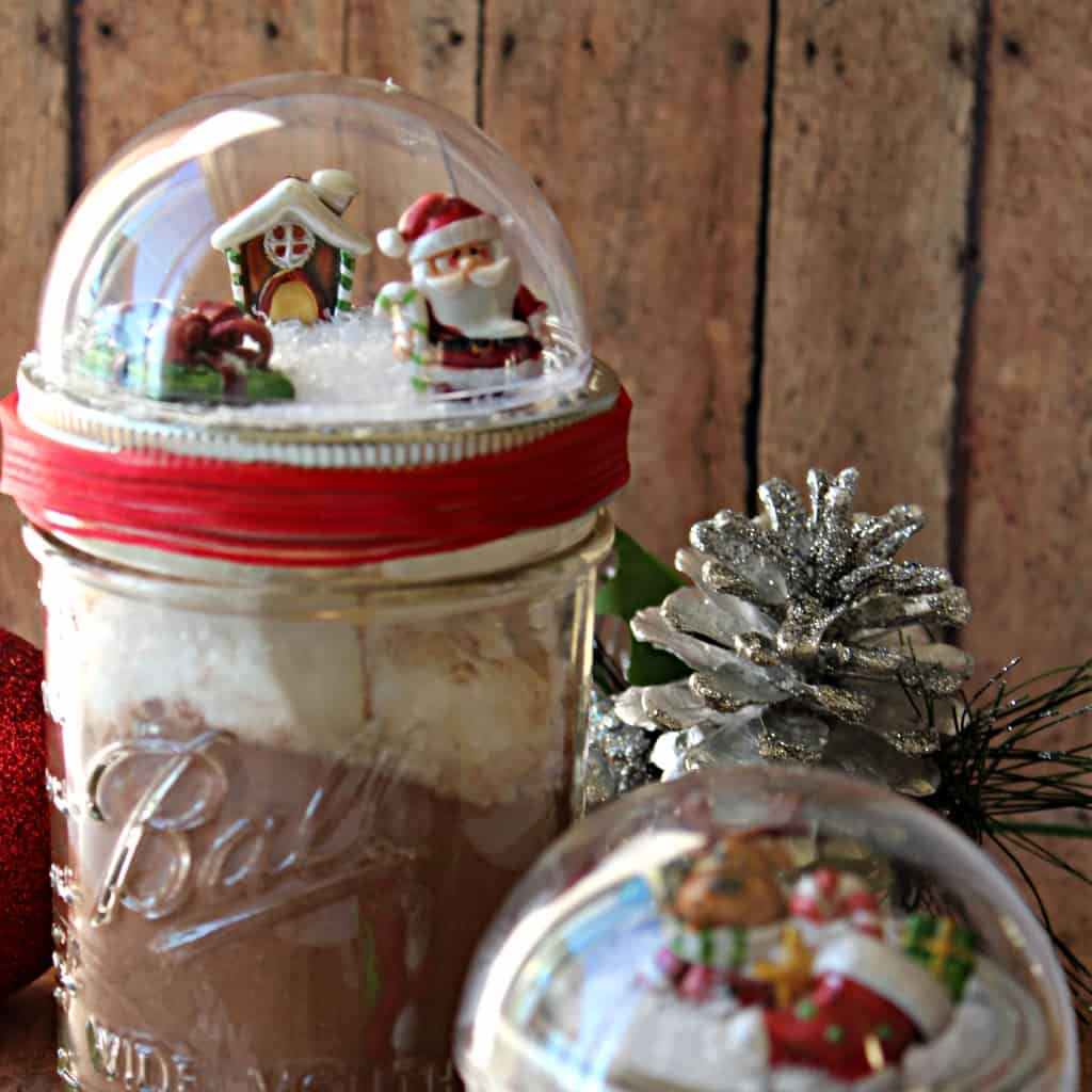 This ridiculously cute craft is something EVERY DIY-er needs to make. No kidding. I want to gift these DIY Mason Jar Snow Globes to everyone on my holiday list!!! #nerdymammablog #masonjar #snowglobe