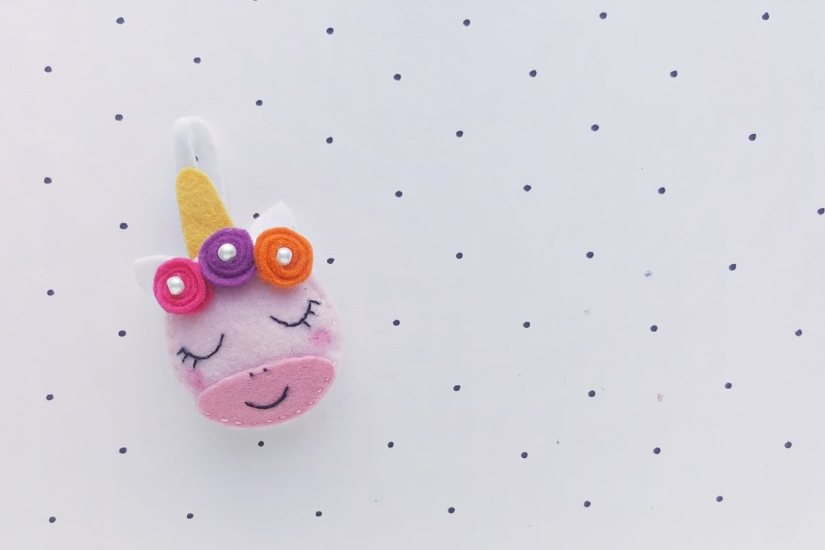 "When my kids asked for Unicorn Ornaments for the Christmas tree, I thought ""sure--I'll just buy some...but then I forgot...and had this brilliant idea to MAKE some! So, here's this adorable DIY Felt Unicorn Ornament tutorial! Yay! #nerdymammablog #unicorn"