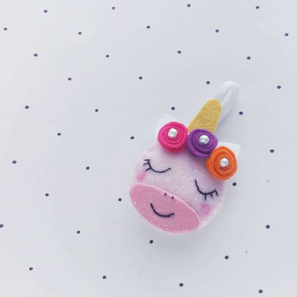 """When my kids asked for Unicorn Ornaments for the Christmas tree, I thought """"sure--I'll just buy some...but then I forgot...and had this brilliant idea to MAKE some! So, here's this adorable DIY Felt Unicorn Ornament tutorial! Yay! #nerdymammablog #unicorn"""