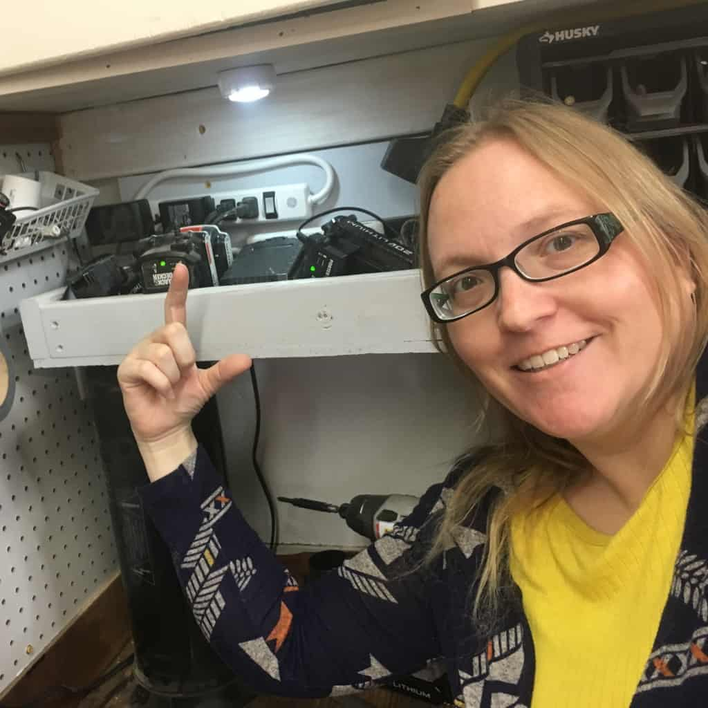 It's made from scrap wood and a few screws and so easy it's not funny, This is How to Make a Small Charging Station (that's Expandable!). #nerdymammablog #diy #workshoporganization