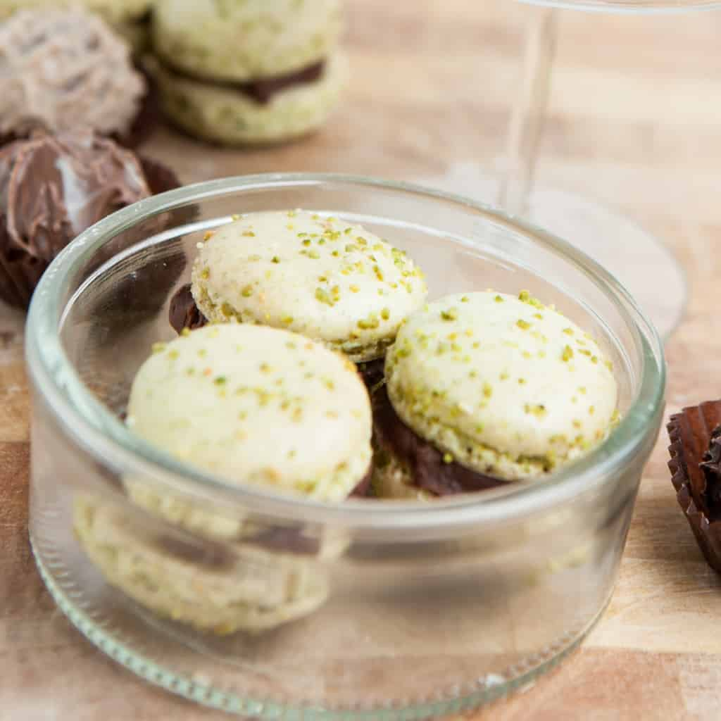 Minty, chocolatey and so perfectly crunchy, this recipe for these Andes Mint Macarons are the perfect french macarons for mint-lovers--or anyone who loves macaron cookies. #nerdymammablog #frenchmacaron #macaroncookies #macaron #mint #recipe #cookie