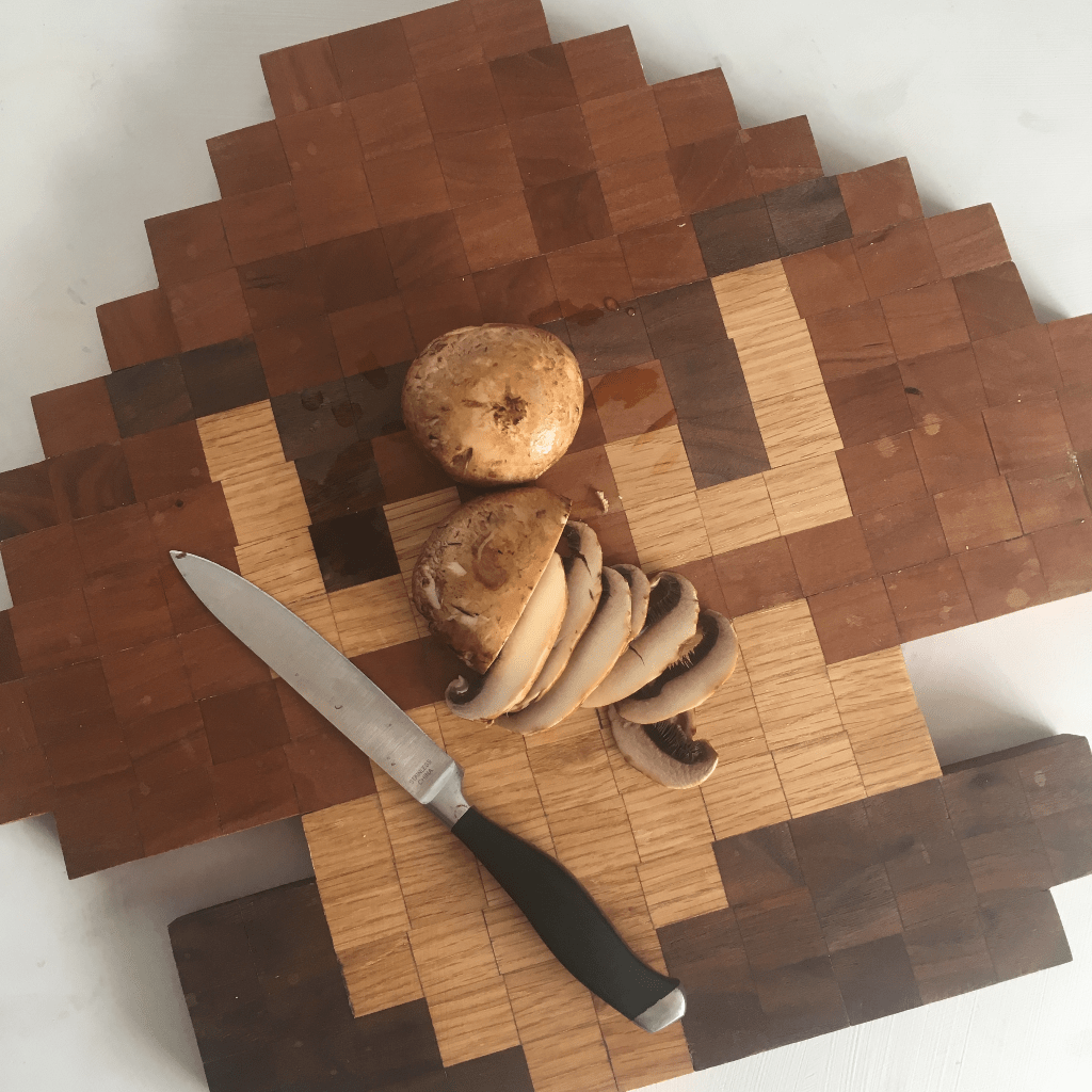 Look, I know that I'm a little nerdy and a little weird. But when I figured out How to Make an 8-Bit Mario Mushroom Cutting Board, I knew I loved every part of me. This is how I did it. #nerdymammablog #DIY #mario #mushroom #cuttingboard
