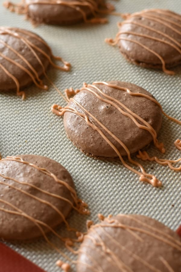 I'm nothing if not honest. And, if I was honest, I would admit that I have an addiction to a certain peanut butter cup. And these Reeces Macarons feed that addiction so well, it's not funny. #nerdymammablog #macaron #frenchmacaron #macaroncookie #cookies #macaronrecipe