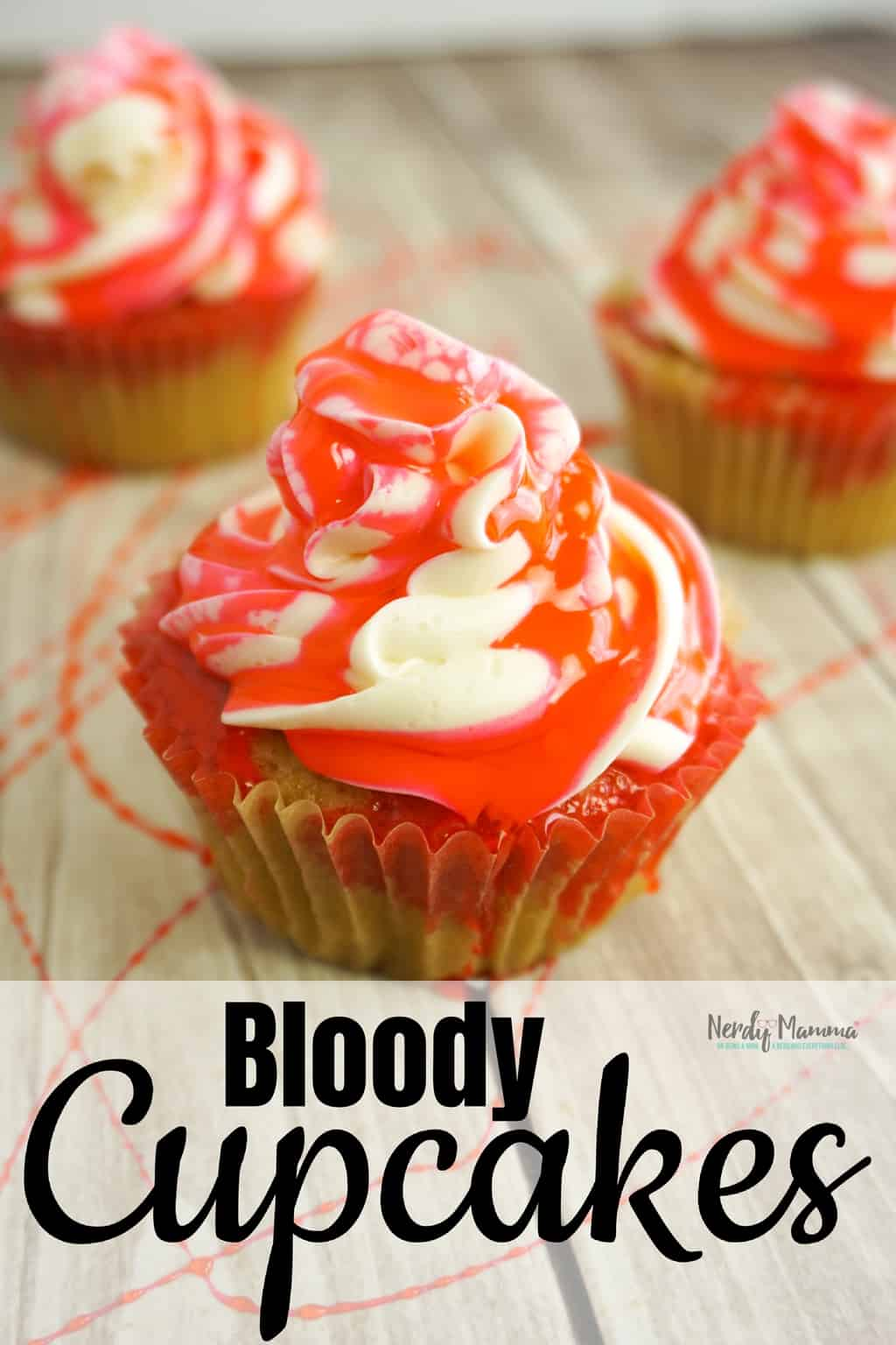 Despite the fact that's its summer, I'm making Bloody Cupcakesbecause I just really miss Halloween. Using fake edible blood, a yummy cupcake and a spoon, I think I succeeded nicely! #nerdymammablog #halloweencupcakes #bloodycupcakes #halloweencupcakerecipe