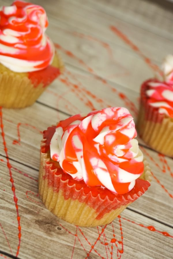 Despite the fact that's its summer, I'm making Bloody Cupcakes because I just really miss Halloween. Using fake edible blood, a yummy cupcake and a spoon, I think I succeeded nicely! #nerdymammablog #halloweencupcakes #bloodycupcakes #halloweencupcakerecipe