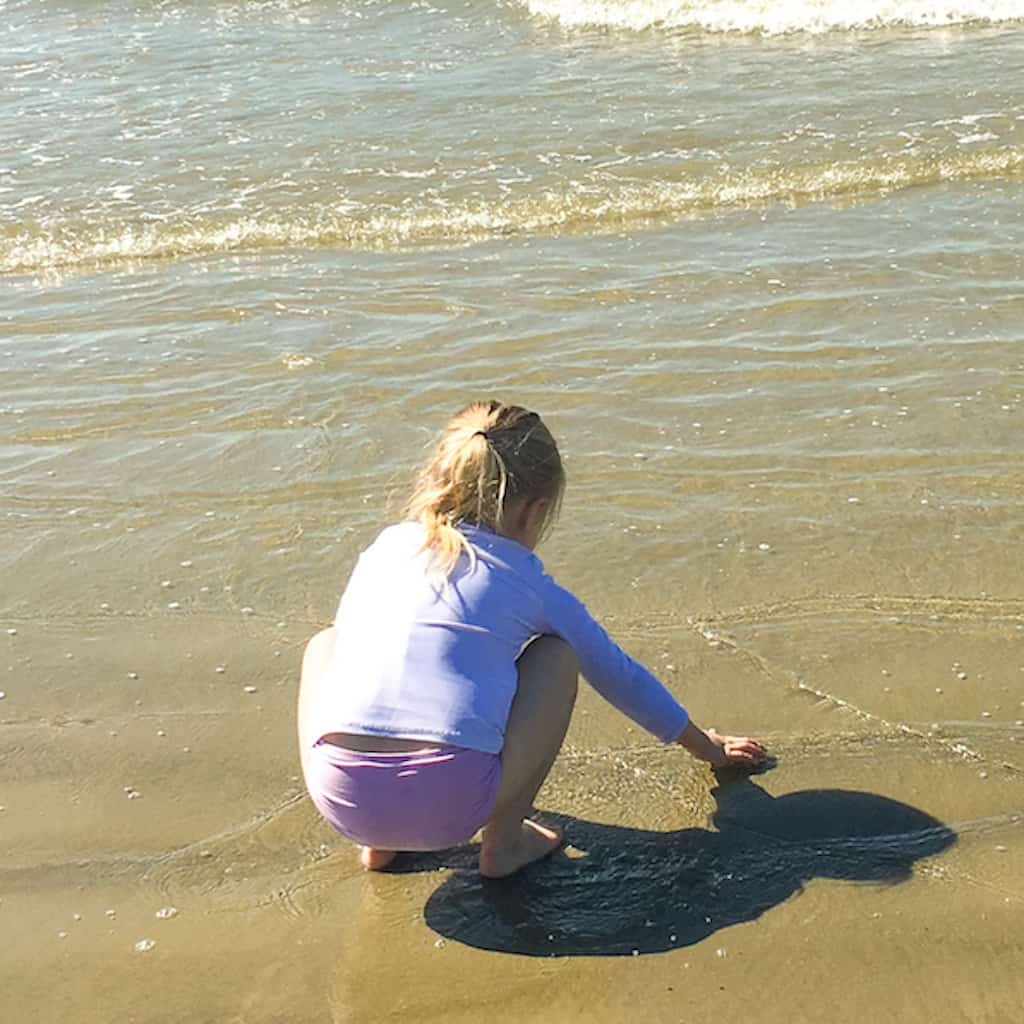 little girl playing on the beach to represent how to teach a preschooler leadership