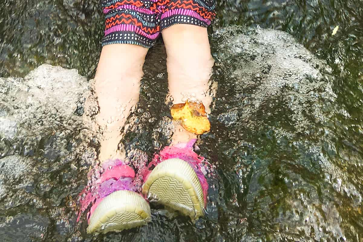 how to teach leadership to preschoolers little girl's feet in a creek waterfall